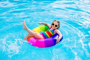 Happy,Little,Girl,Playing,With,Colorful,Inflatable,Ring,In,Outdoor